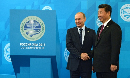 Russian President Vladimir Putin, left, shakes hands with Chinese President Xi Jinping ahead of the Shanghai Cooperation Organization (SCO) summit in Ufa, Russia, Friday, July 10, 2015.