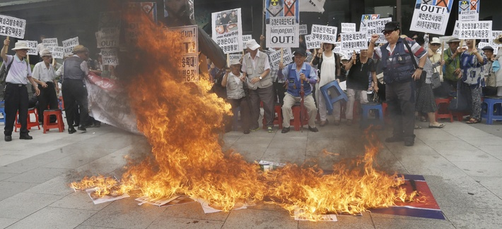 South Korean protesters burn an effigy of North Korean leader Kim Jong Un and a North Korean flag in Seoul, South Korea.
