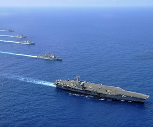 Aircraft carrier USS Nimitz, guided-missile cruiser USS Chosin, guided-missile destroyers USS Sampson and USS Pinkney, and guided-missile frigate USS Rentz operate in formation in the South China Sea.