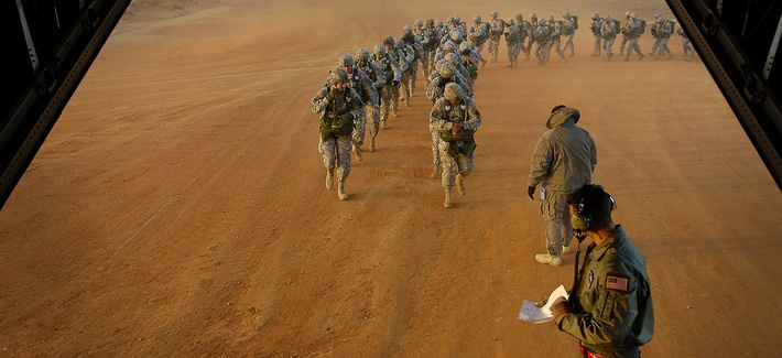 U.S. Army paratroopers prepare to board a C-130 Hercules during Operation Toy Drop, Ft. Bragg, N.C., December 8, 2007.