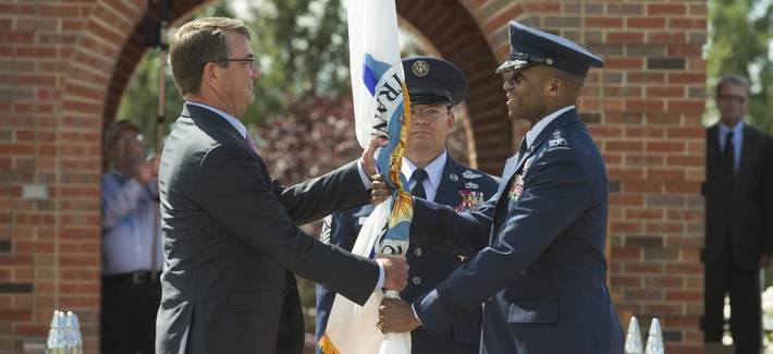 Defense Secretary Ash Carter hands the U.S. Transportation Command colors to new Commander Gen. Darren McDew, Aug. 26, 2015 at Scott Air Force Base, Ill.