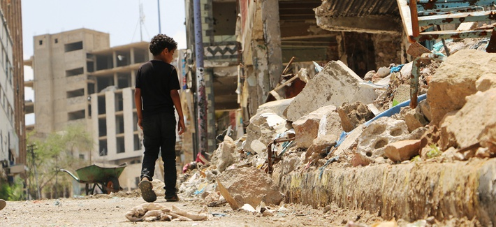 A boy walks near the rubbles of houses destroyed during fighting between tribal fighters and Shiite rebels known as Houthis in Taiz, Yemen, Sunday, Aug. 23, 2015.
