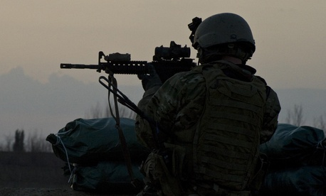 A U.S. Army military information support operations sergeant with Special Operations Task Force-South provides security overwatch in Kandahar province's Zharay District in Afghanistan in 2011.