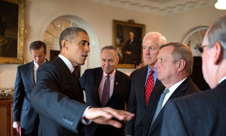 President Barack Obama speaks with a group of U.S. Senators following a meeting with the bipartisan, bicameral leadership of Congress in the Cabinet Room of the White House, Jan. 13, 2015.