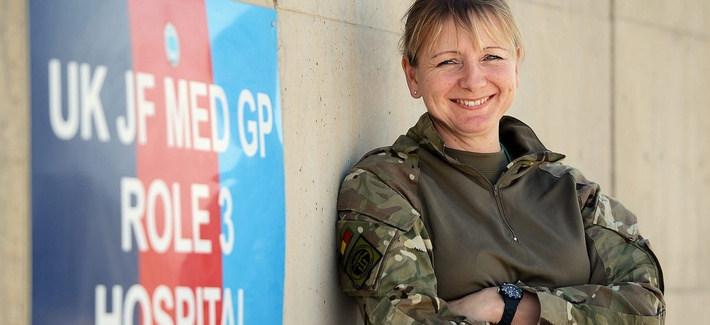 A Royal Army Reserves Cultural Specialist officer at one of the Afghan National Army (ANA) hospital wards at Camp Shorabak, Helmand Province, Afghanistan, in 2014.