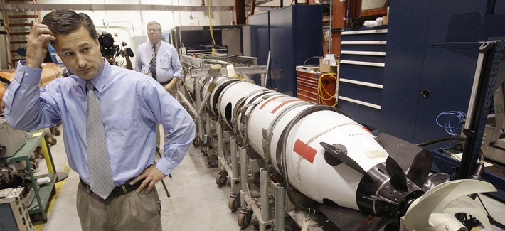 Christopher Del Mastro, head of anti submarine warfare mobil targets stands next to an unmanned underwater vehicle (UUV) in a lab at the Naval Undersea War Center in Middletown, RI., Tuesday, July 31, 2012.