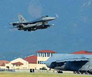 A USAF F-16 Fighting Falcon accompanies about 300 airmen and cargo from Aviano Air Base, Italy, to Incirlik Air Base, Turkey, in support of Operation Inherent Resolve on Aug. 9, 2015.