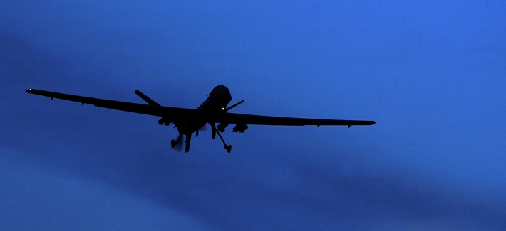 An unmanned U.S. Predator drone flies over Kandahar Air Field, southern Afghanistan, on a moon-lit night, Jan. 31, 2010.