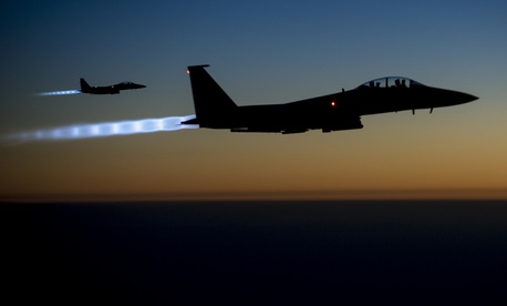 wo U.S. Air Force F-15E Strike Eagle aircraft fly over northern Iraq Sept. 23, 2014, after conducting airstrikes in Syria.