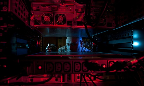 U.S. Air Force Staff Sgt. Jerome Duhan, a network administrator, inserts a hard drive into the network control center retina server at Altus Air Force Base in preparation for a command cyber readiness inspection.