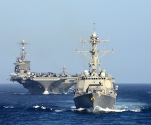 The guided-missile destroyer USS William P. Lawrence (DDG 110), front, leads the aircraft carrier USS John C. Stennis (CVN 74) off the coast of San Clemente Island near Southern California, Aug. 4, 2015.