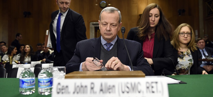 Special Presidential Envoy for the Global Coalition to Counter IS, retired Gen. John R. Allen prepares to testify on Capitol Hill, Feb. 25, 2015, before the Senate Foreign Relations Committee.