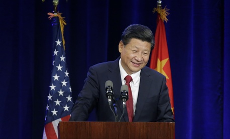On his way to Washington, Chinese President Xi Jinping speaks Tuesday, Sept. 22, 2015, in Seattle.