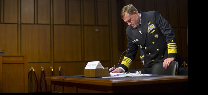 Director of the National Security Agency (NSA) Adm. Michael Rogers, waits for the arrival of Senate Intelligence Committee members before taking their seats on Thursday, September 24, 2015.