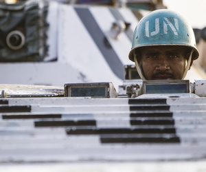 "A peacekeeper serving with the Indian military contingent of the UN Mission in South Sudan (UNMISS) during a ""stand to"" drill in Pibor, Jonglei State."