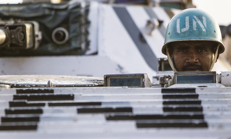 """A peacekeeper serving with the Indian military contingent of the UN Mission in South Sudan (UNMISS) during a """"stand to"""" drill in Pibor, Jonglei State."""