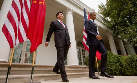 President Barack Obama and Chinese President Xi Jinping arrive for their joint news conference, Friday, Sept. 25, 2015, in the Rose Garden at the White House in Washington.