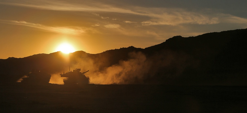 U.S. Army Soldiers, assigned to the Arkansas National Guard, pass through a breach cleared by a Mine Clearing Line Charge during Decisive Action Rotation 15-09 at the National Training Center, Fort Irwin, Calif. Aug. 16, 2015.