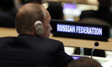 Russia's President Vladimir Putin listens to addresses in the 70th session of the United Nations General Assembly, Monday, Sept. 28, 2015.