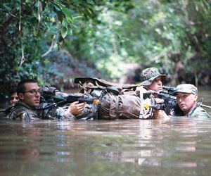 Soldiers in the Jungle Operations Training Course in Hawaii train in 'survival, communication, navigation, waterborne operations, traversing, knots, evasion, marksmanship and patrol base operations.' Sept. 23, 2015.