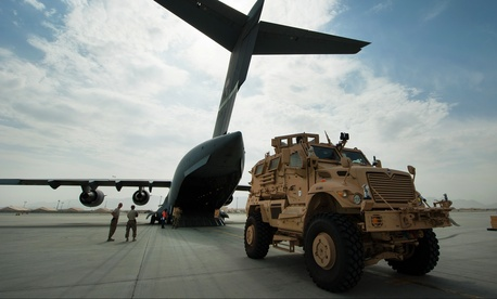 In Afghanistan, a U.S. Army mine-resistant, ambush-protected, or MRAP, vehicle offloads from an Air Force C-17 Globemaster III aircraft at Bagram Airfield, Sept. 21, 2015.