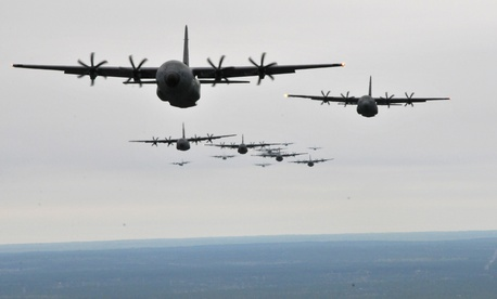 C-130J Hercules and WC-130J Hercules fly in formation during an Operation Surge Capacity exercise April, 5, 2014, over the Mississippi Gulf Coast region.