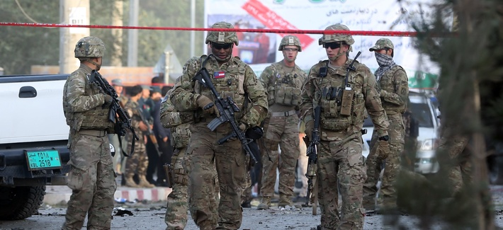 U.S. soldiers inspect the site of a suicide attack in the heart of Kabul, Afghanistan, Saturday, Aug. 22, 2015.