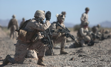 U.S. Marines with 2nd Battalion, 7th Marine Regiment, 1st Marine Division, 1st Marine Expeditionary Force set up perimeter security during a fast rope exercise at Auxiliary Airfield 2, Yuma, Ariz., Oct. 2, 2015.