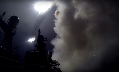 A screen capture from a YouTube video posted by the Russian Ministry of Defense shows the launch of cruise missiles toward Syrian targets.