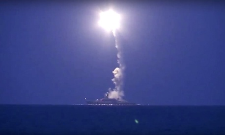 In this photo made from the footage taken from Russian Defense Ministry official web site, Wednesday, Oct. 7, 2015, a Russian navy ship launches a cruise missile in the Caspian Sea.