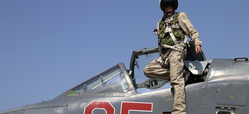 A Russian pilot in his SU-25M fighter at Hmeimim airbase in Syria, Saturday, Oct. 3. Russian forces would escalate attacks in Syria the following week.