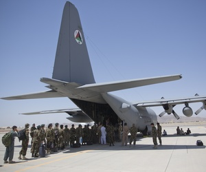 In this Tuesday, Aug. 18, 2015 photo, Afghan National Army soldiers line up to get into a C-130 Hercules, at Kandahar Air Base, in Kandahar, Afghanistan.