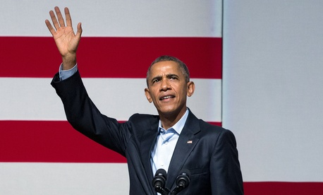 President Barack Obama waves to guests as he takes the stage during a Democratic fundraiser at the Warfield Theater, Saturday, Oct. 10, 2015 in San Francisco.