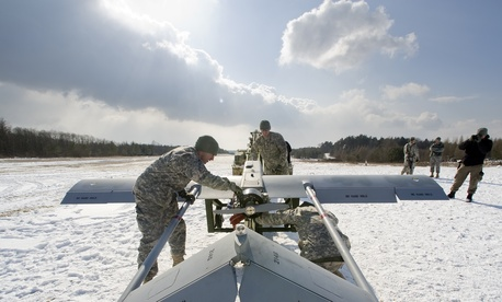 Members of the Nomad troop, 2nd Stryker Calvalry Regiment, US Army Europe, prep their Shadow unmanned aeirial vehicle for launch at Hohenfels Training Area.