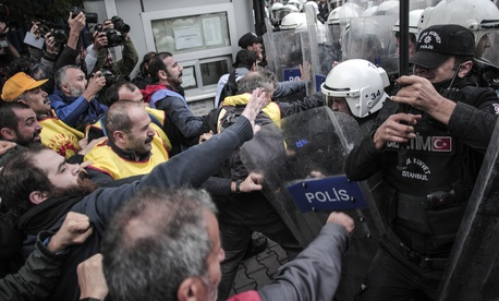 Protesters clash with police in Istanbul, Turkey, Tuesday, Oct. 13, 2015.