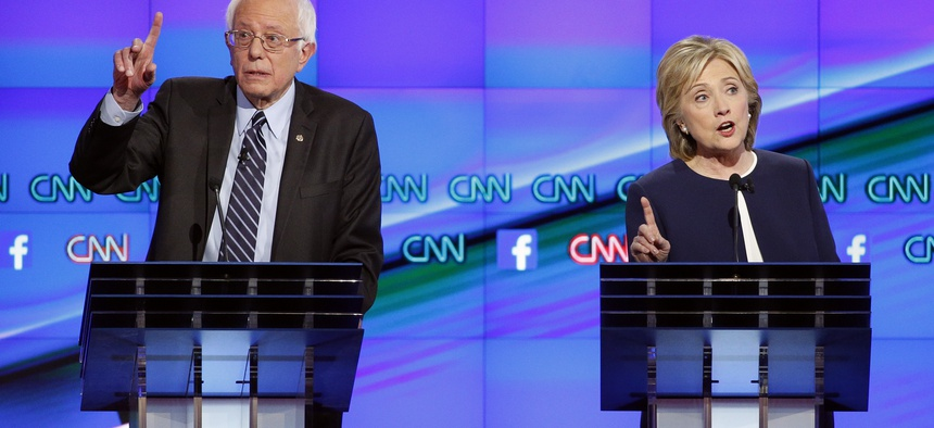 Former Secretary of State Hillary Clinton and Vermont Sen. Bernie Sanders spar at the CNN Democratic presidential debate in Las Vegas, Tues, Oct. 13, 2015.