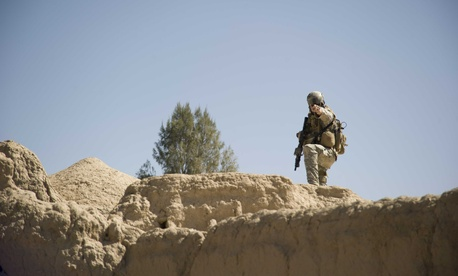 A U.S. Special Forces sergeant directs security positions during a patrol Feb. 20, 2011 in Panjwai District, Kandahar province, Afghanistan.