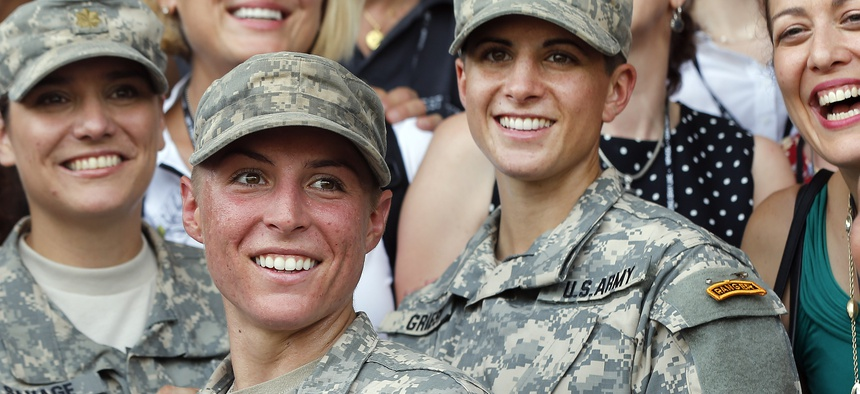 U.S. Army First Lt. Shaye Haver, center, and Capt. Kristen Griest, right, at Ranger school graduation, Aug. 21, 2015.