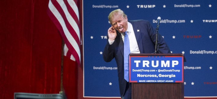 Republican presidential candidate Donald Trump reacts to his introduction during a campaign rally held at the North Atlanta Trade Center, Saturday, Oct., 10, 2015, in Norcross, Ga.