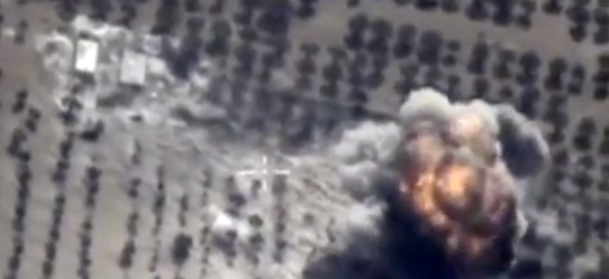 In this photo made from the footage taken from Russian Defense Ministry official web site on Thursday, Oct. 1, 2015 a bomb explosion is seen in Syria.