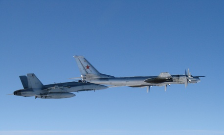 A CF-18 Hornet from 4 Wing Cold Lake flies next to a Russian Tu-95 Bear bomber on September 5.