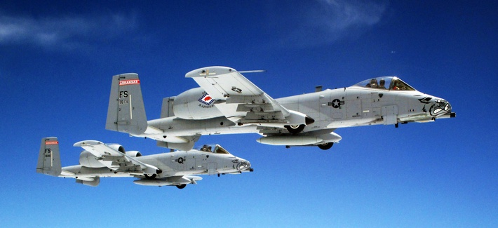 A pair of Air Force A-10 Thunderbolt II aircraft fly in formation June, 7, 2014 over Kansas.