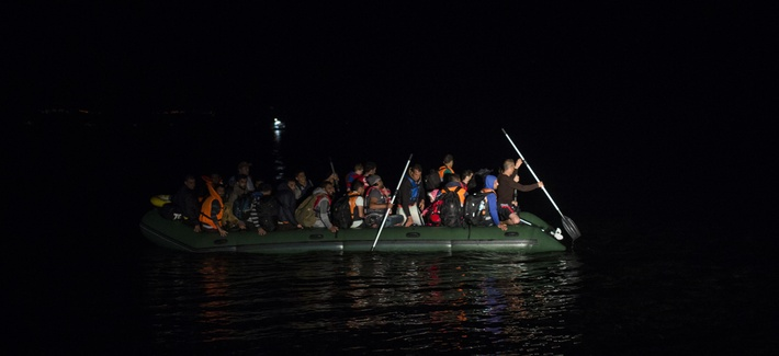 Migrants and refugees arrive on a dinghy from the Turkish coast to the northeastern Greek island of Lesbos, Monday, Oct. 19, 2015. More than 600,000 people, mostly Syrians, have reached Europe since the beginning of this year.