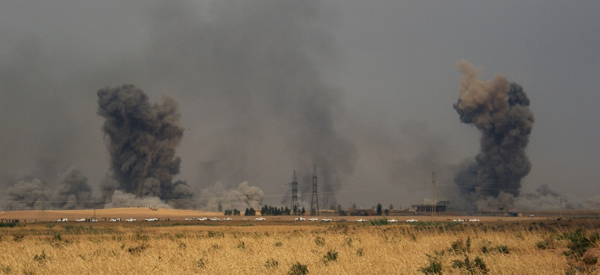 Smoke rises during a military operation launched by Kurdish troops known as peshmerga to regain control of some villages from Islamic State group west of the oil-rich city of Kirkuk, 180 miles (290 kilometers) north of Baghdad, Iraq, Sept. 30, 2015.