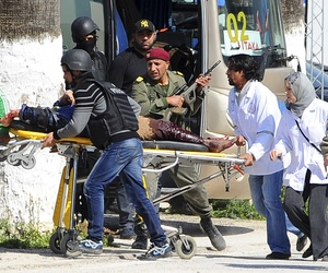A victim is evacuated by rescue workers outside the Bardo museum in Tunis, Tunisia, on March 18, 2015.