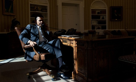 Here, in the midst of the morning light, the President talks on the phone with British Prime Minister David Cameron.