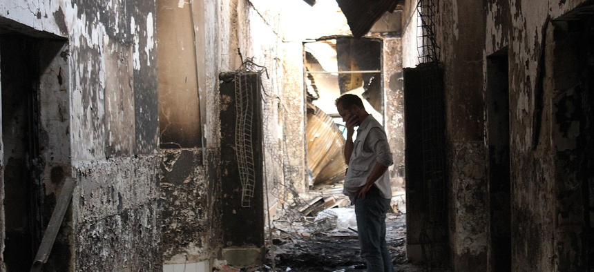 An employee of Doctors Without Borders stands in the hospital in Kunduz, Afghanistan, the day after an errant U.S. air attack, Oct. 16, 2015.