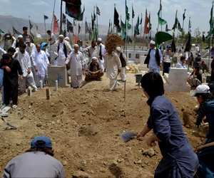 People bury victims of a suicide bombing in Quetta, Pakistan, Monday, July 1, 2013. The militant group Lashkar-e-Jhangvi, which has carried out many attacks against Shiites in recent years, claimed responsibility.