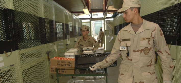 Joint Task Force Guantanamo, Guantanamo Bay, Cuba (13 Feb 2006)- A U.S. Navy Masters at Arms deliver lunch to detainees in Camp Delta.