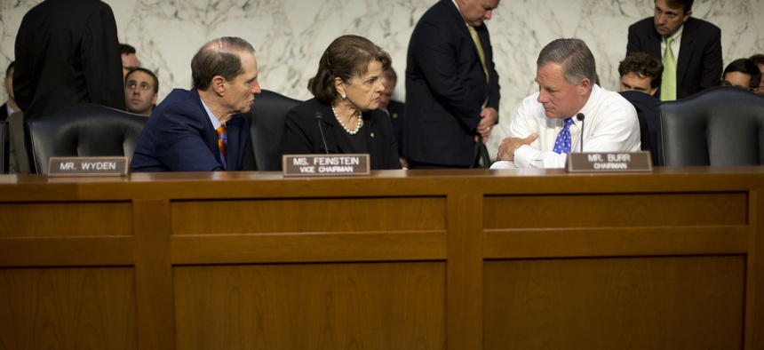 Senate Intelligence Committee Chairman Sen. Richard Burr, R-N.C., right, confers with committee Vice-Chair. Sen. Dianne Feinstein, D-Calif., center, and committee member Sen. Ron Wyden, D-Ore., on Capitol Hill, Thursday, Sept. 24, 2015.